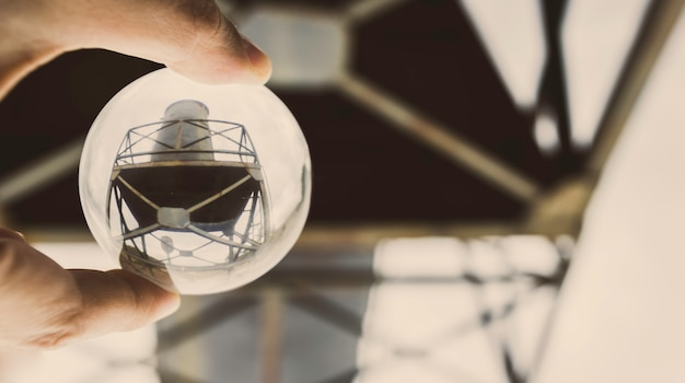 Iron structure and water tank reflected inside a crystal ball