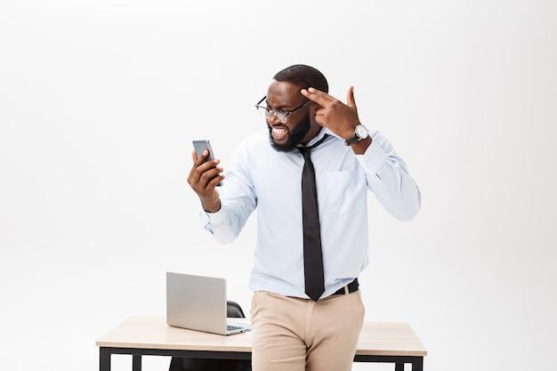 Irritated dark skinned young male enterpreneur being
