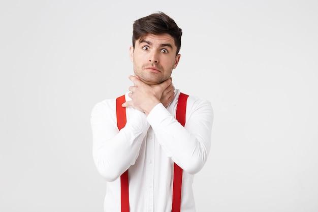 Irritated man making suicide gesture, tries to choke himself