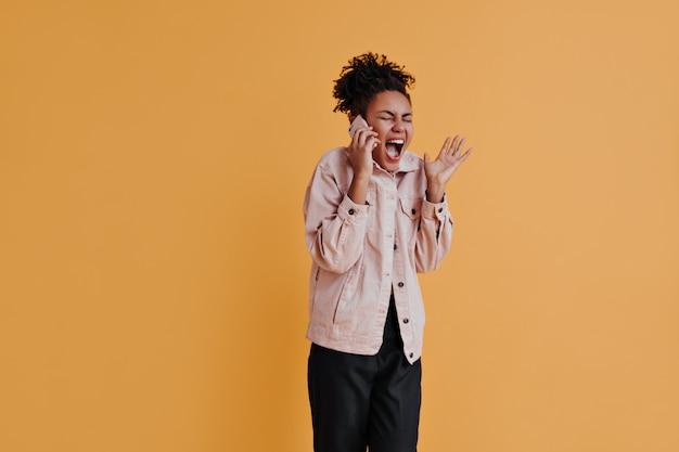 Irritated woman talking on smartphone