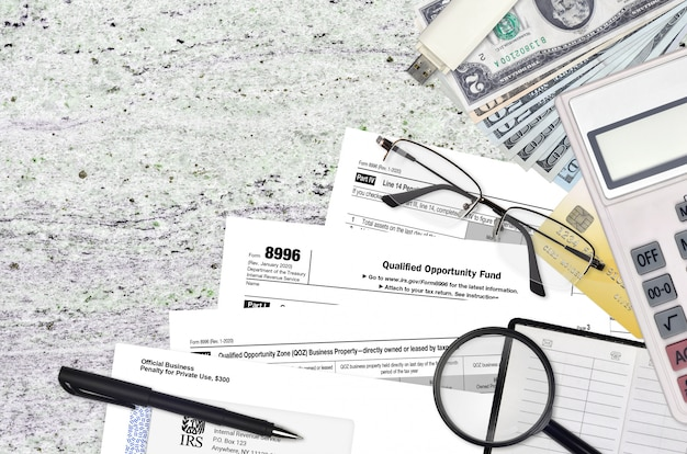 Irs form 8996 qualified opportunity fund lies on flat lay office table