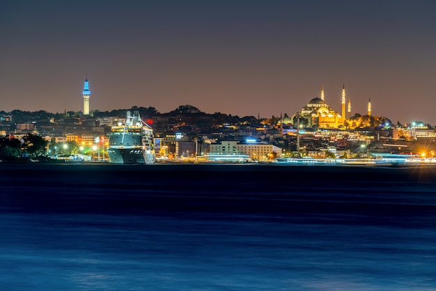 Is tanbul city and mosque at night in turkey. and yacht