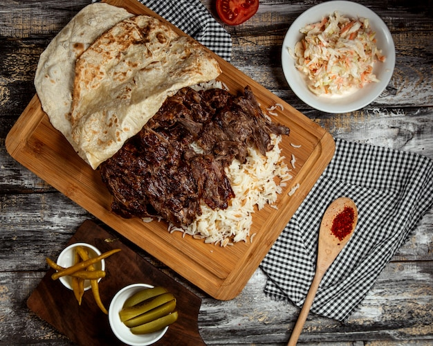 Iskender kebab with rice and lavash