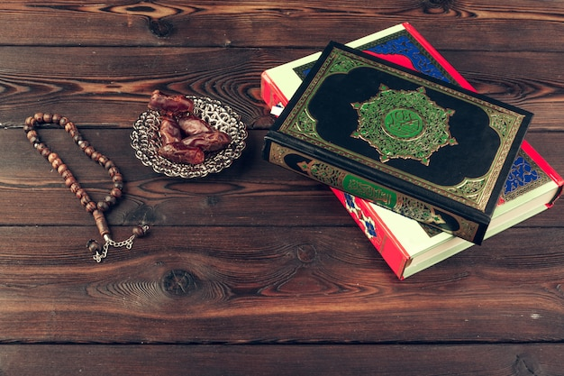 Islamic holy book on wooden table