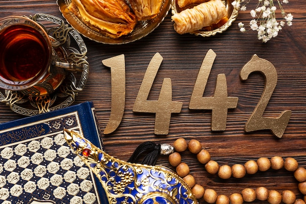 Islamic new year decoration with praying beads and glass of tea
