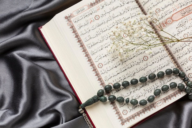 Islamic new year decoration with praying beads on quran