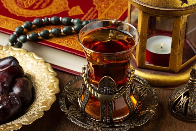 Islamic new year decoration with praying beads and tea
