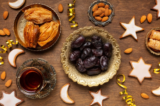Islamic new year decoration with traditional food and tea