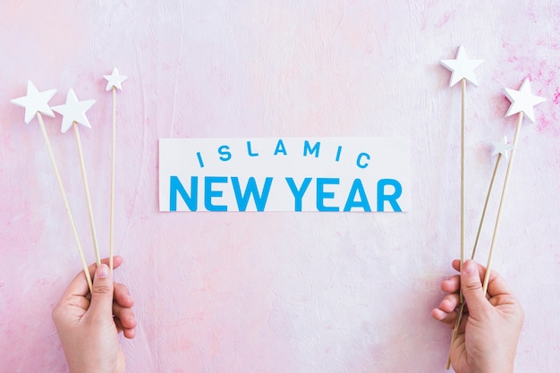 Islamic new year and hands with stars
