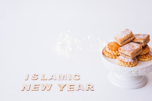 Islamic new year inscription and cookies
