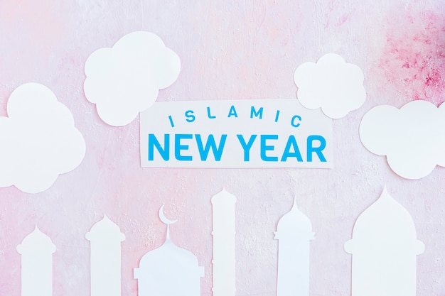 Islamic new year paper in clouds overmosque