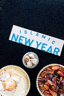 Islamic new year paper and traditional desserts