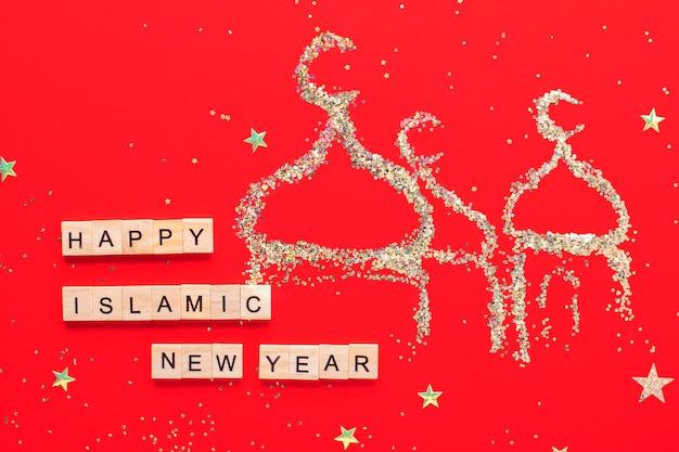 Исламский новый год. надпись happy islamic new year на красном фоне, мечеть из блесток.