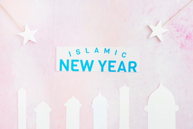 Islamic new year with mosque and stars on pink