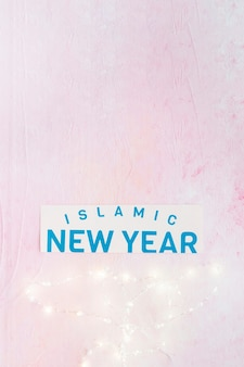 Islamic new year word and lighting fairy lights