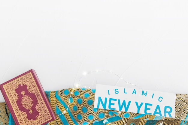 Islamic new year words and koran on tablecloth