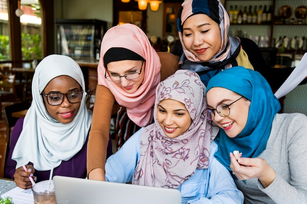 Islamic women friends working together