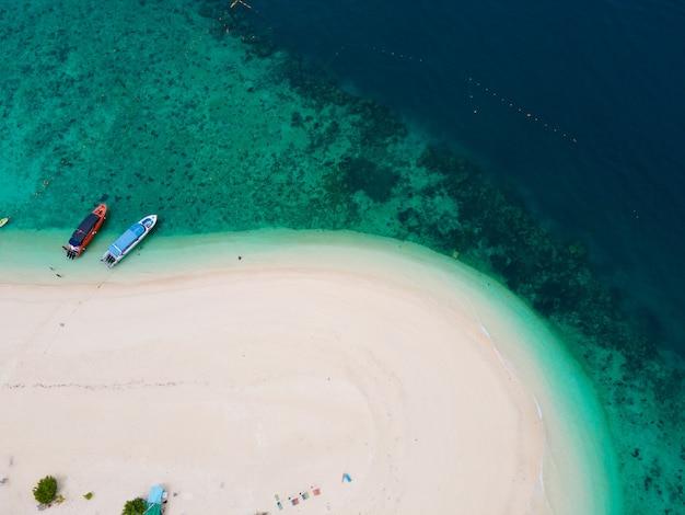 Island beach sand top view.