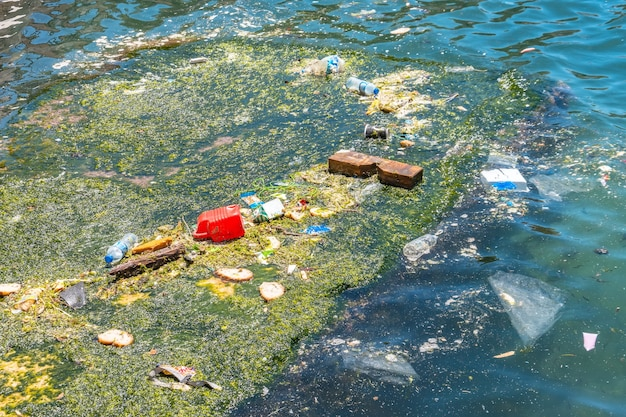 The island of garbage floats in the sea.
