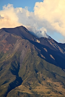 Island of stromboli with smoke issuing from the mouth of the volcano