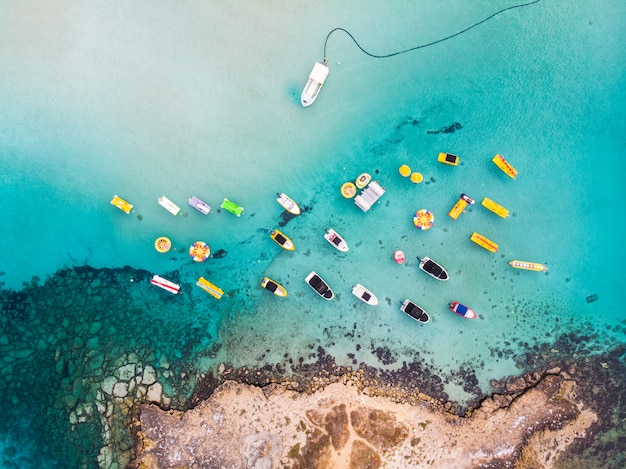 Island with boats parked near fig tree bay beach