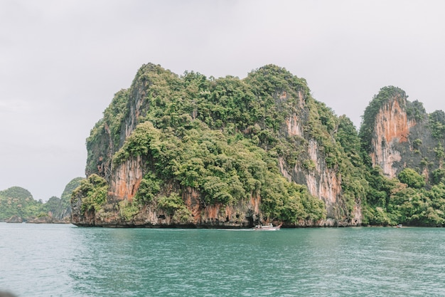 Island with green mountains in krabi thailand and sea views
