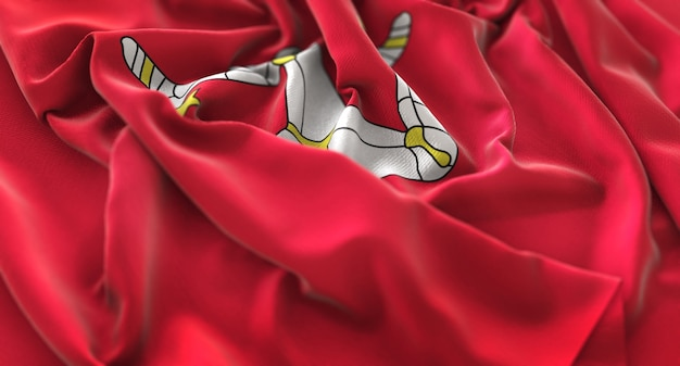 Isle of man flag ruffled beautifully waving macro close-up shot