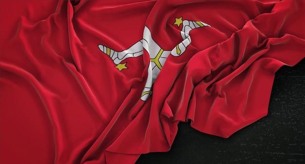 Остров мэн флаг морщинистый на темном фоне 3d render