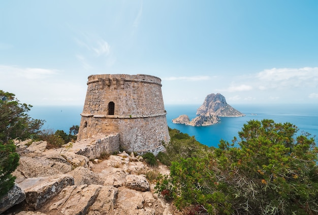 Islets of es vedra and es vedranell, from the tower des savinar, in the natural park of cala d'hort, ibiza, spain