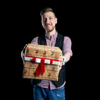 Isolate man holding a box gifts in hands on sale