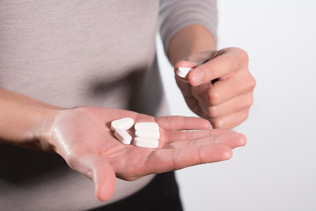 Isolate of the women hand holding the medicines, medicine recovery concept
