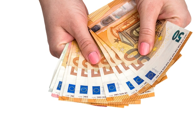 Isolated 50 euros of banknotes in their hands