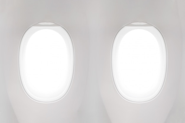 Isolated airplane window from customer seat view on white background