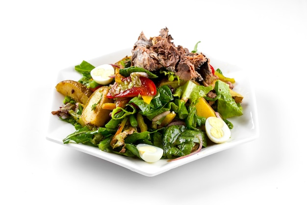 Isolated anchovies nisoise salad on the white