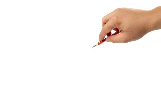Isolated asian man's right hand holds one colour pencil for drawing and painting somthing on white background. clipping path.
