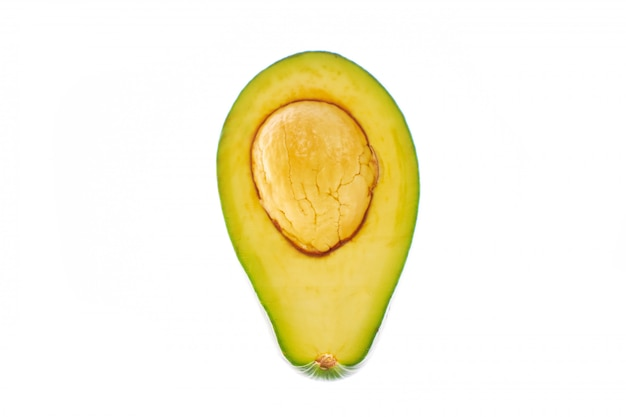 Isolated avocado with one half and seed