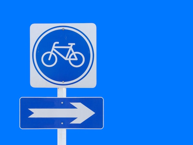 Isolated bicycle with arrow board sign with clipping path