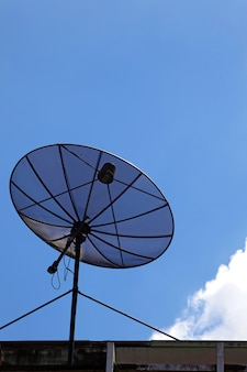 Isolated of black satellite with sunny sky