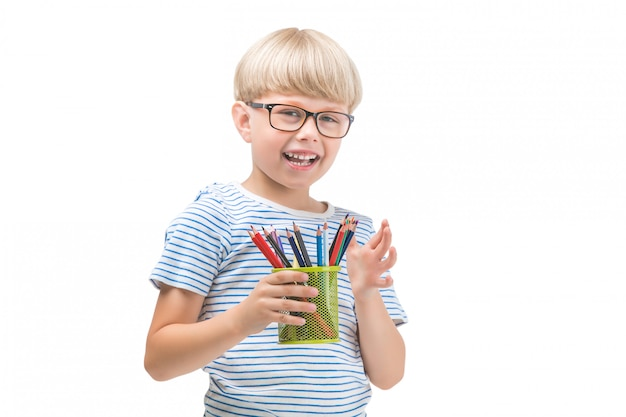 Isolated child with pencils. adorable kid on white background. portrait of funny blonde boy with colorful pencils.