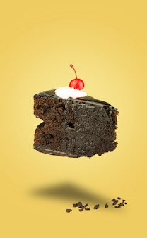 Isolated chocolate cherry cake flying on yellow background