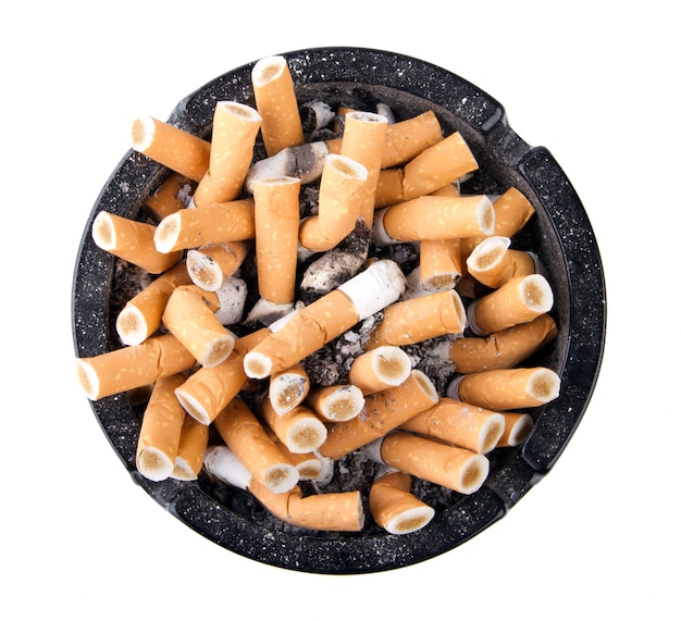 Isolated ciggarette ashtray full of butts and ash.