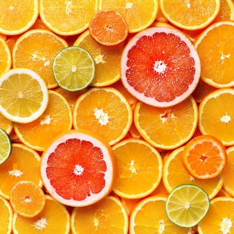 Isolated citrus fruits. pieces of lemon, lime, pink grapefruit and orange isolated, with clipping path