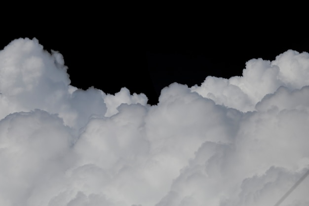 Isolated clouds over black save with clipping path.