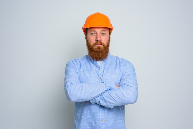 Isolated confidant architect with beard and orange helmet