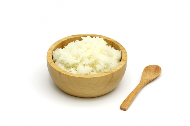 Isolated cooked jasmine rice in the wooden bowl on white