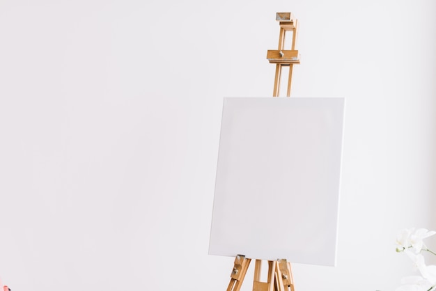 Isolated easel with empty canvas