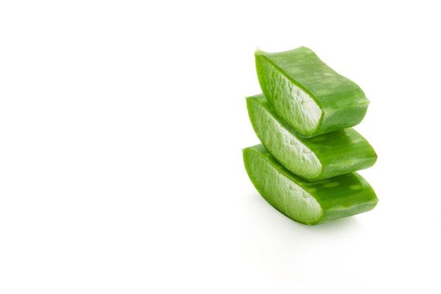 Isolated fresh aloe vera leaves sliced on white background. aloe vera gel have medical properties for wound healing.