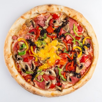 Isolated ham and vegetables pizza with mushrooms
