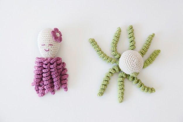 Isolated handmade woolen toys for children shaped as octopus