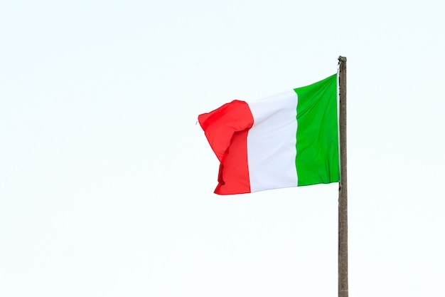 An isolated italian flag waving in the wind, italy